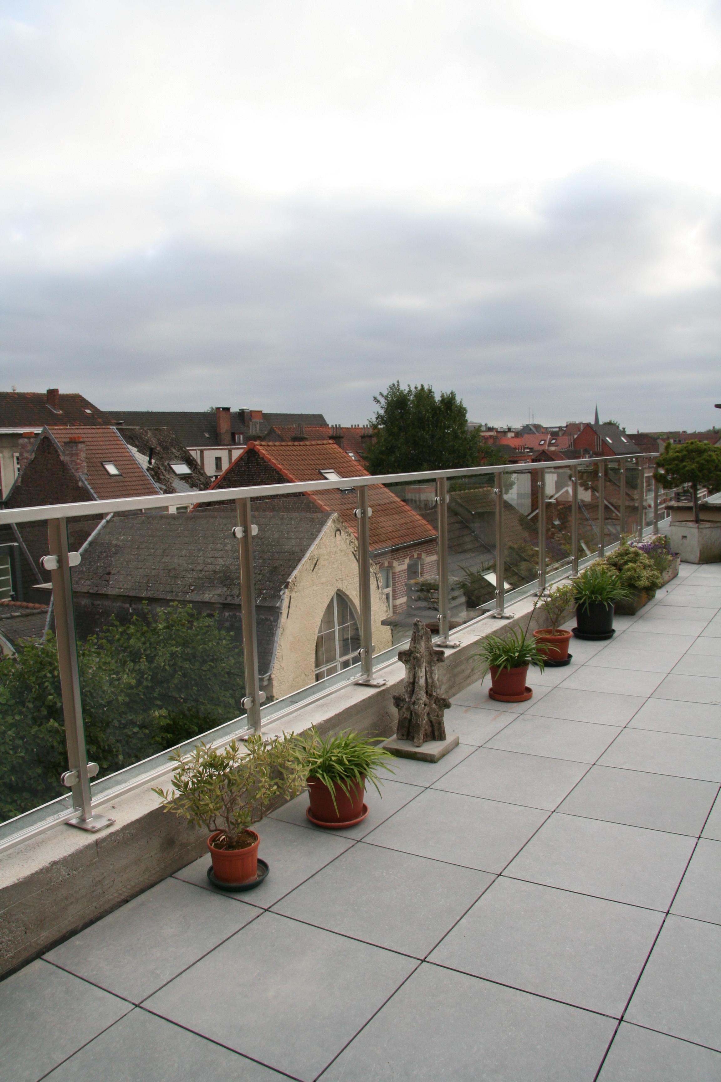 inox terrasafsluiting met glasafwerking